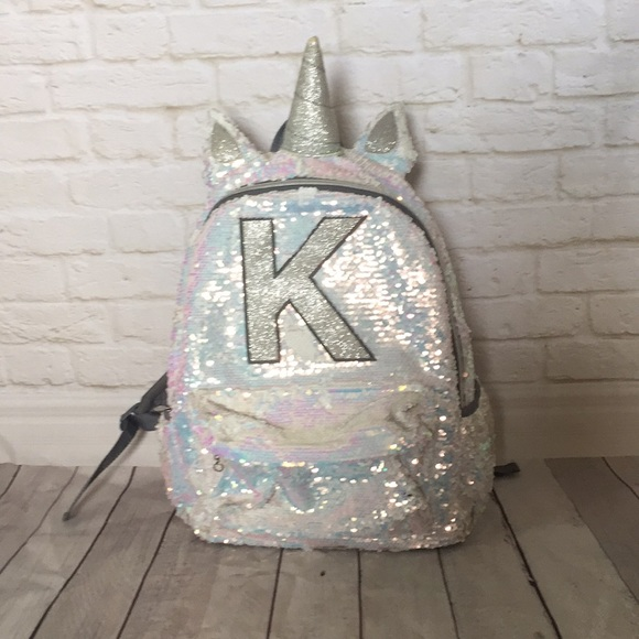 df22e89cf4 Justice Other - Justice flip sequin unicorn backpack Initial K